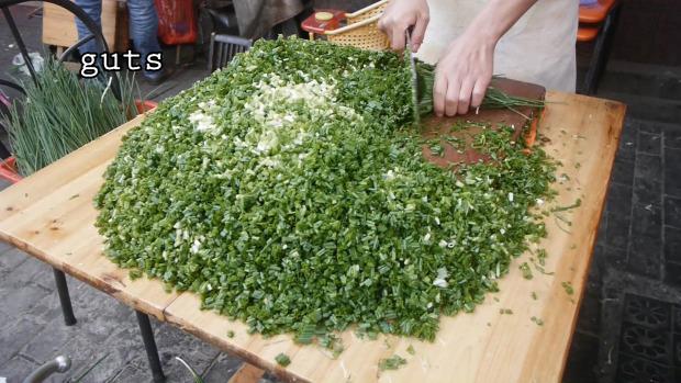 Street Food Kína utcai árus élelmiszer tészta táska zöldhagyma