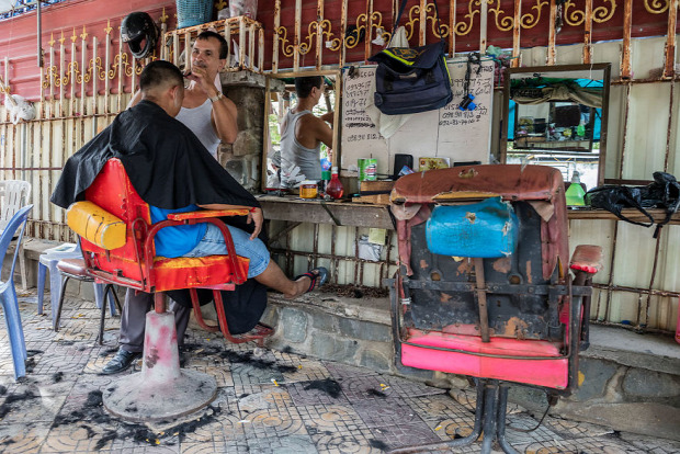 A világ érdekes Kampodzsa Phnom Penh borbély fodrác utca