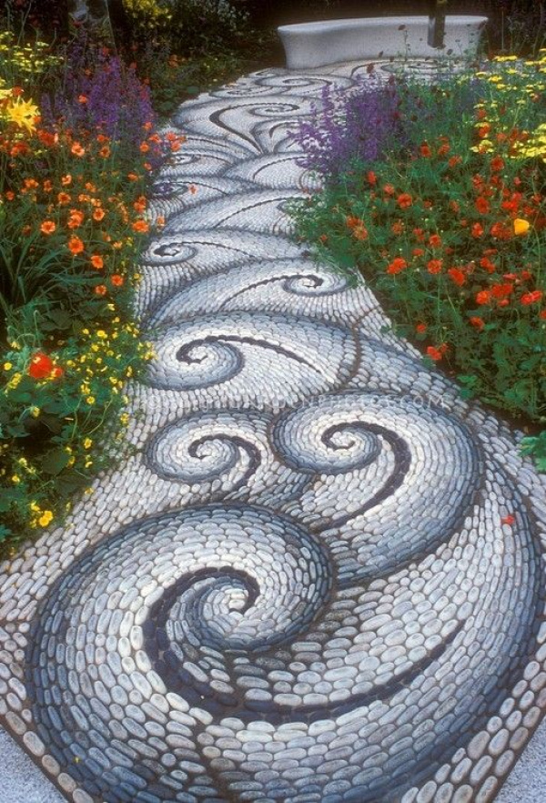 River Rocks Mosaic Path. A lot of work, but an awesome way to improve a bland concrete pathway you can't take up.