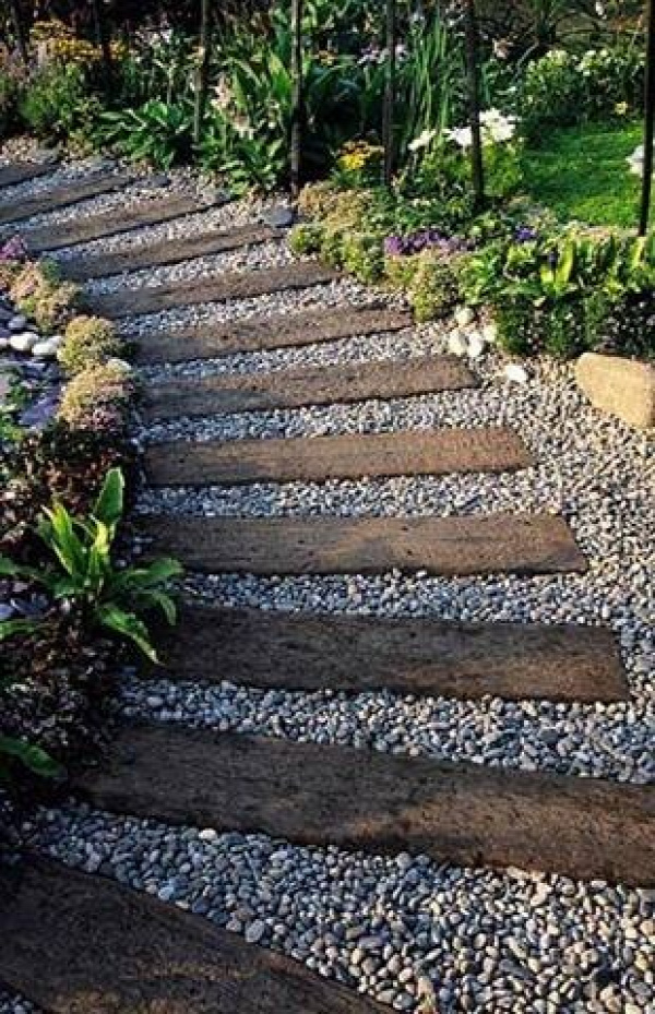 Used railroad ties ( or 4x4s ) and pea gravel--- id like to put this path thru my garden......