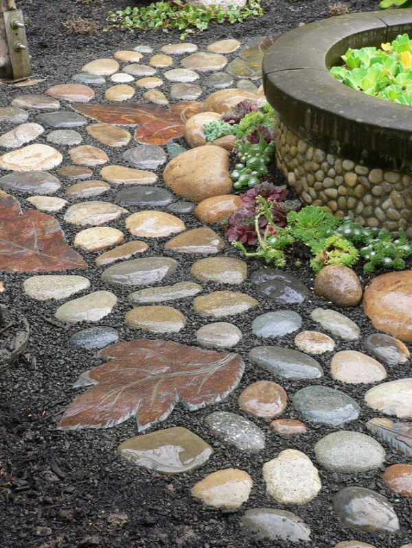 Garden path of rocks and the stepping stone made from a leaf mold.