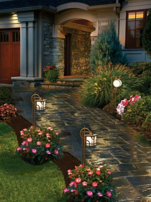 having a walkway to your door is great curb appeal. the lights add a nice touch at night. flowers along the pathway is also a great way to attract the eye to the pathway.