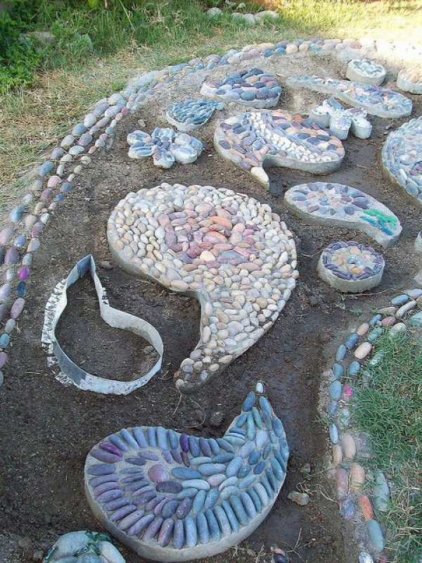 Pebble Mosaic walkway in progress - also has bed borders and garden glass flowers from plates in the photo stream.