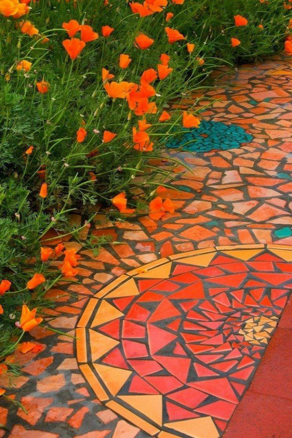 Love the combination here ... the gorgeous orange in the mosaic picked up by the flowers.