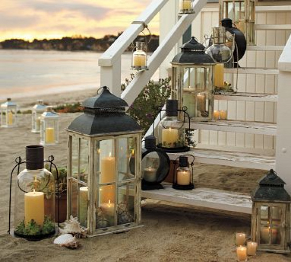 Gary and Elaine watched in awe as the lanterns performed their annual ritual of emerging from the sea and making their way up the back steps.