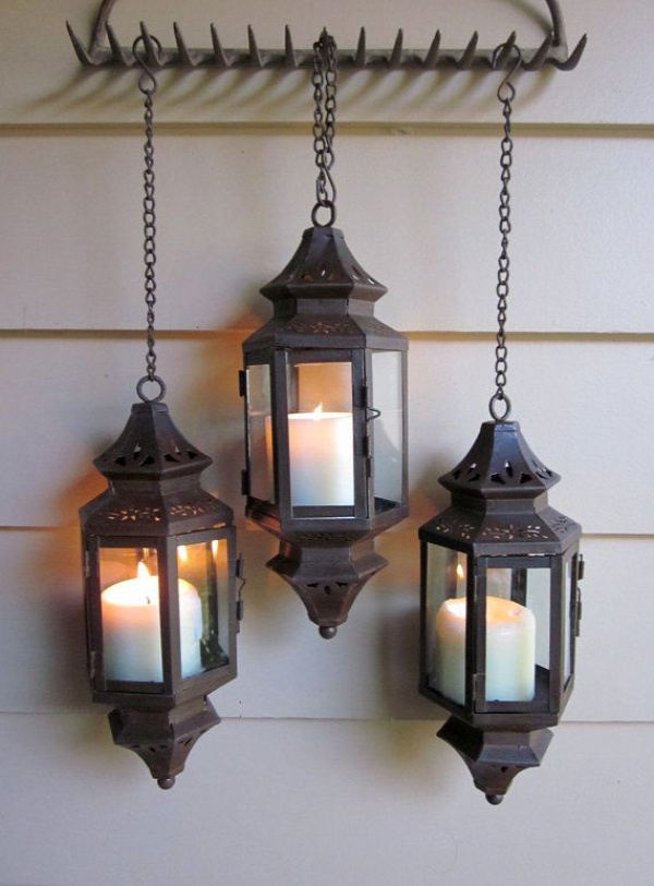 I love the idea of hanging a grouping of...who knows...from a rake head. Don't love these particular lanterns though.