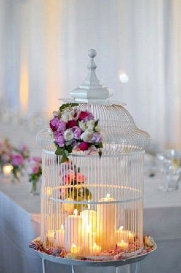Bunch of candles inside a bird cage-- very unique centerpiece Original Source: http://ruffledblog.com/2010/04/marissa-adrians-vintage-australian-artdeco-wedding/
