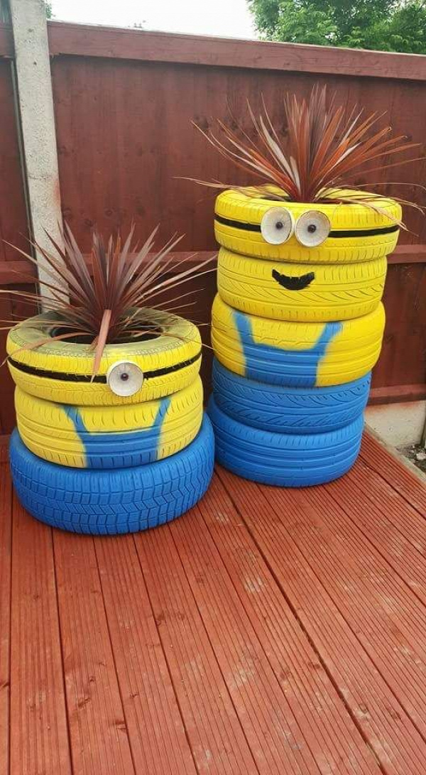 Minion planters made from old tires.