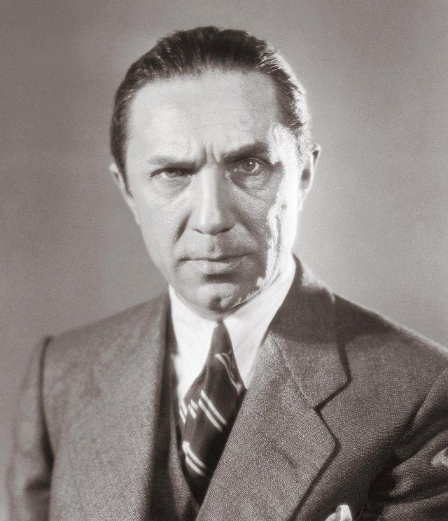 színész